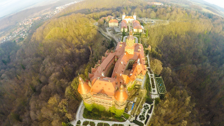 Castle Zamek Ksiaz Is one of the biggest tourist attraction in lower Silesia near Wroclaw, Poland. Wide angle view from drone of this magnificent medieval and baroque building in winter.