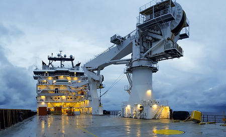modern offshore vessel with dynamic positioning systems at night