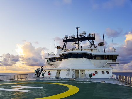 sunset at sea with view of modern offshore rov / construciton support vessel Reklamní fotografie