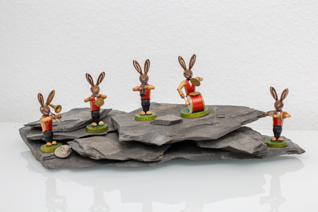 Easter bunny big band play music on a rock Stock Photo
