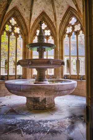 Historical fountain in the fountain house in Maulbronn cloister Foto de archivo