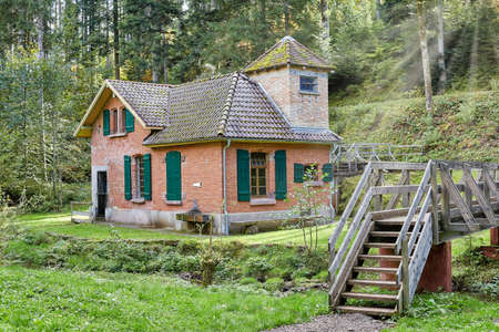 Waterworks, water house made of brick in the forest in Germany