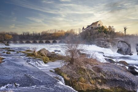 Waterfall, Cascade, Rhine Falls beneath Laufen castle at sunset Banque d'images