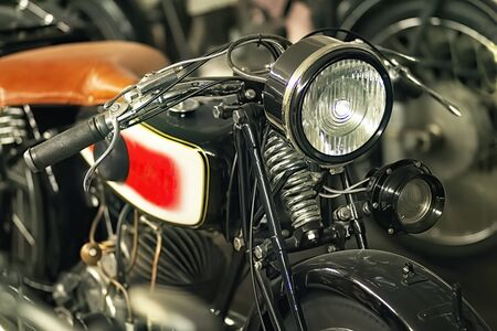 Front, tank and lamp of a historic motorcycle Imagens