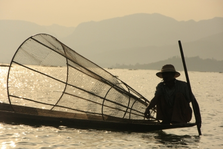 Inle lake fisherman at sunset, Shan state, Myanmar, Southeast Asia