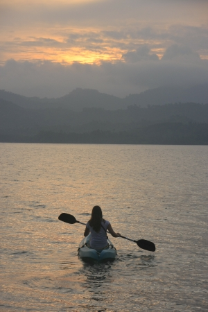 Sea kayaking at sunrise Stock Photo - 14583128