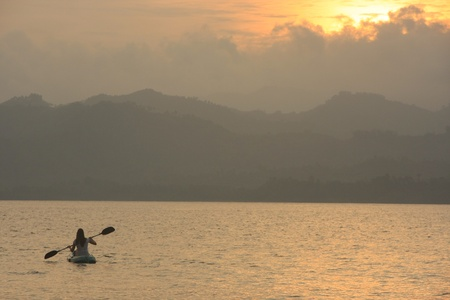 Sea kayaking at sunrise photo