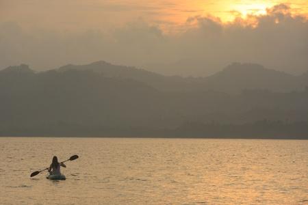 Sea kayaking at sunrise photo