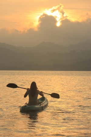 canoe paddle: Sea kayaking at sunrise