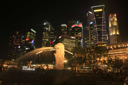 Merlion statue and skyline at night, Singapore