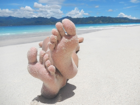 buttom: Sandy feet on a tropical beach