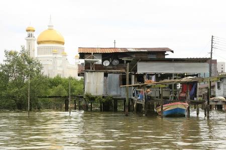 stilts: Stilt houses of Kampong Ayer and Sultan Omar Ali Saifudding Mosque, Bandar Seri Begawan, Brunei, Southeast Asia Editorial