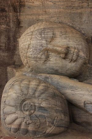 polonnaruwa: Portrait of reclining Buddha carved from rock, Polonnaruwa, Sri Lanka Stock Photo