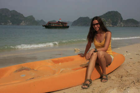 Young woman sitting on kayak, Halong Bay, Vietnam photo