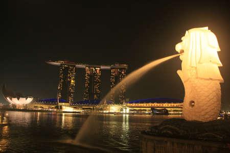 floodlit: Merlion statue and Marina Bay Sand resort at night, Singapore Editorial