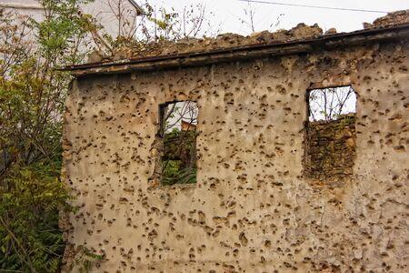 bosnia and hercegovina: Bullet holes on wall, Mostar, Bosnia and Herzegovina Stock Photo