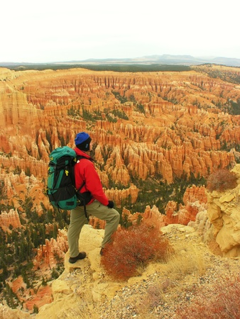 Backpacker resting at Inspiration Point, Bryce Canyon Utah, USA photo