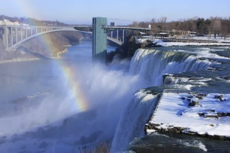 Niagara Falls and Rainbow Bridge in winter, New York, USA photo