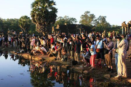 Tourists photographing sunrise at Angkor Wat, Siem Reap, Cambodia Editöryel