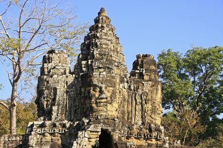 Stone faces of South Gate, Angkor Thom, Angkor area, Siem Reap, Cambodia photo