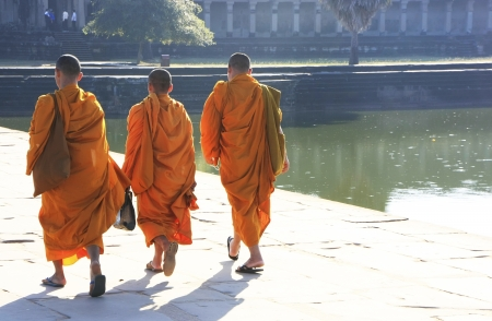 Monks walking into a temple, Angkor Wat, Siem Reap, Cambodia