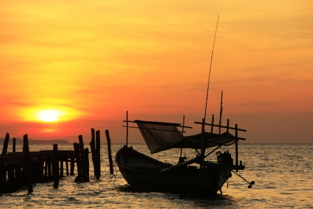 rung: Silhouette of traditional fishing boat at sunrise, Koh Rong island, Cambodia, Southeast Asia