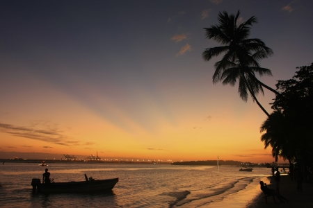 chica: Boca Chica beach at sunset, Dominican Republic Stock Photo