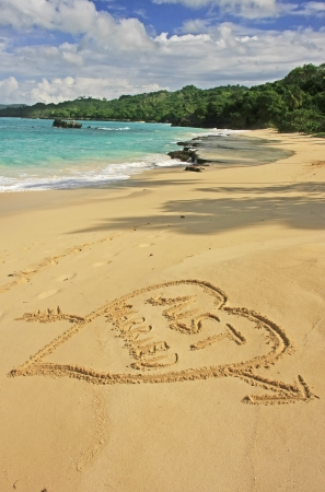 Just married written in sand on a beach photo
