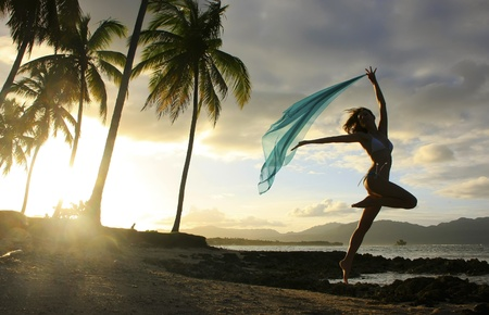 Silhouette of young woman jumping at Las Galeras beach, Samana peninsula, Dominican Republic