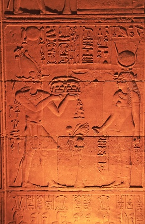 Ancient hieroglyphics on the wall of Philae Temple, Lake Nasser, Egypt photo