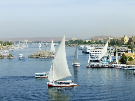 Felucca boats sailing on the Nile river, Aswan, Egypt