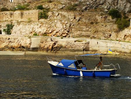 Motorboat in Balaklava Bay, Crimea, Ukraine photo