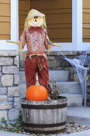 Halloween scarecrow with pumpkin photo