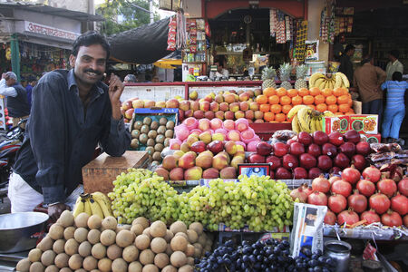 Indian man selling fruites at the market, Bundi, Rajasthan, India