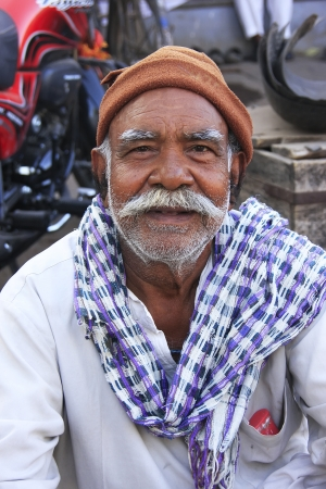 Indian man sitting at the market, Bundi, Rajasthan, India
