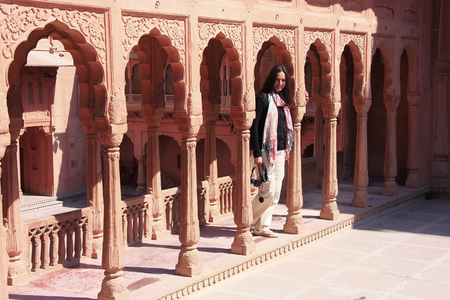bikaner: Young woman standing on courtyard terrace, Junagarh fort, Bikaner, Rajasthan, India