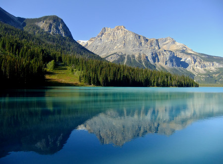 Mountains reflected in Emerald Lake, Yoho National Park, British Columbia, Canada Stock Photo
