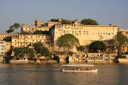 ghat: Motorboat going in front of City Palace complex, Udaipur, Rajasthan, India