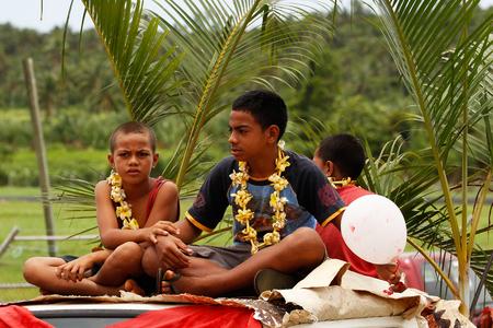 Tongan boys celebrate arriving Fuifui Moimoi on Vavau island, Tonga