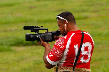 taking video: Tongan man taking video of Fuifui Moimoi arriving on Vavau island, Tonga Editorial