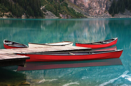 Red canoes at Lake Ohara, Yoho National Park, British Columbia, Canada