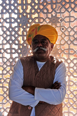Indian man standing by the window at Mehrangarh Fort, Jodhpur, Rajasthan, India