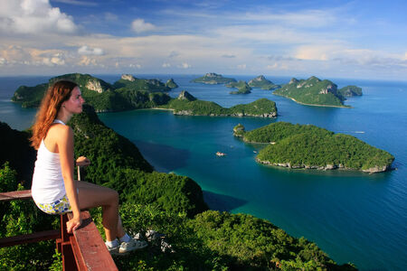 Young woman sitting at the view point, Wua Talab island, Ang Thong National Marine Park, Thailand