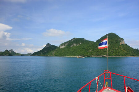 Tourist boat cruising Ang Thong National Marine Park, Thailand photo