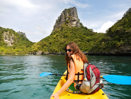 Young woman kayaking in Ang Thong National Marine Park, Thailand photo