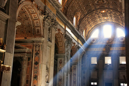 crepuscular: Interior of Saint Peters Basilica with crepuscular rays, Vatican City, Rome