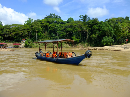 negara: Tourist boat on Tembeling river, Taman Negara National Park, Malaysia Stock Photo