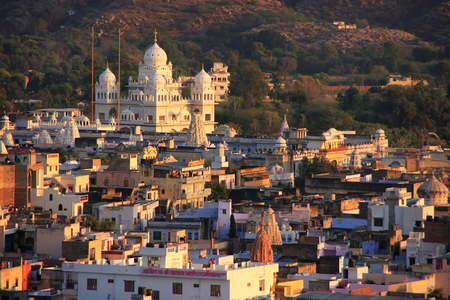 gurudwara: View of Pushkar with Gurudwara temple in the evening, Rajasthan, India Stock Photo