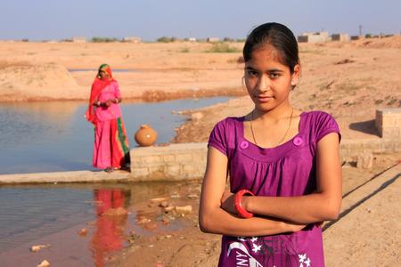 ghat: Local girl standing near water reservoir, Khichan village, Rajasthan, India