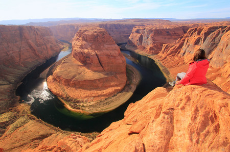 Young woman enjoying view of Horseshoe bend, Arizona photo